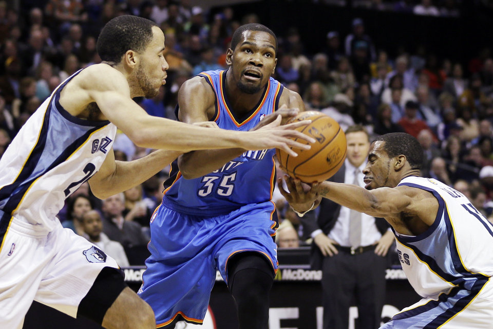 Photo - Oklahoma City Thunder's Kevin Durant (35) is pressured by Memphis Grizzlies' Mike Conley, right, and Tayshaun Prince, left, during the first half of an NBA basketball game in Memphis, Tenn., Wednesday, March 20, 2013. (AP Photo/Danny Johnston) ORG XMIT: TNDJ101