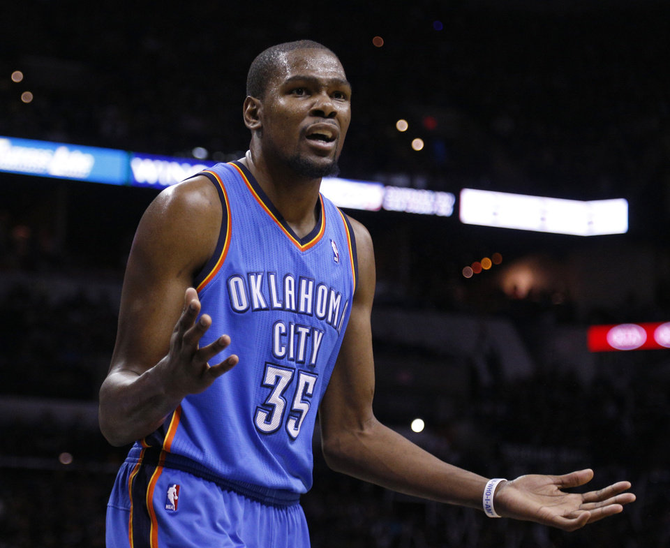 Photo - Oklahoma City's Kevin Durant (35) reacts to a call during Game 1 of the Western Conference Finals in the NBA playoffs between the Oklahoma City Thunder and the San Antonio Spurs at the AT&T Center in San Antonio, Monday, May 19, 2014. Photo by Sarah Phipps, The Oklahoman