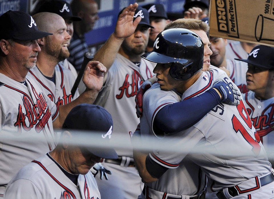 Photo - Atlanta Braves' Andrelton Simmons, right, celebrates with Atlanta Braves' Freddie Freeman after Simmons hit a solo home run in the first inning of a baseball game against the Philadelphia Phillies on Saturday, July 6, 2013, in Philadelpia. (AP Photo/Michael Perez)