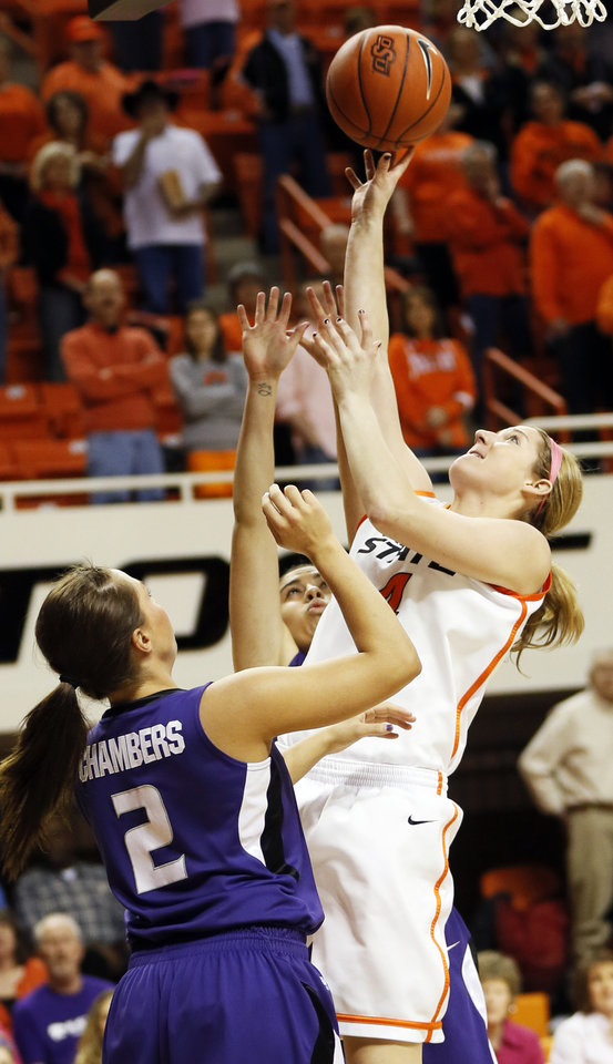 Photo - Oklahoma State's Liz Donohoe (4) shoots between Kansas State's Brittany Chambers (2) and Brianna Craig (20), back, during an NCAA women's basketball game between Oklahoma State University (OSU) and Kansas State at Gallagher-Iba Arena in Stillwater, Okla., Saturday, Feb. 16, 2013. Photo by Nate Billings, The Oklahoman