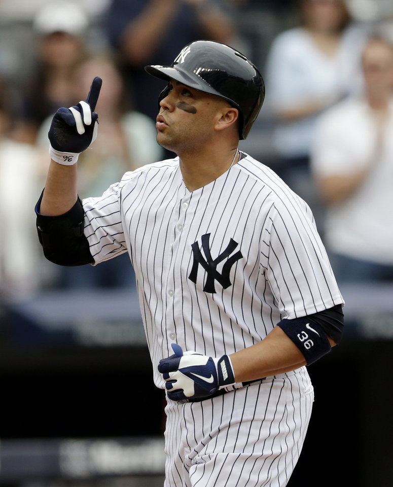 Photo - New York Yankees' Carlos Beltran gestures skyward as he runs the bases after hitting a home run off Cincinnati Reds starting pitcher Alfredo Simon during the second inning of a baseball game, Saturday, July 19, 2014, at Yankee Stadium in New York. (AP Photo/Julio Cortez)