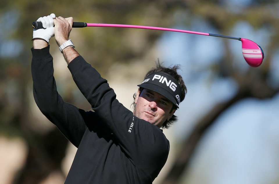 Photo - Bubba Watson hits his tee shot at the second hole during the final round of the Phoenix Open golf tournament on Sunday, Feb. 2, 2014, in Scottsdale, Ariz. (AP Photo/Ross D. Franklin)
