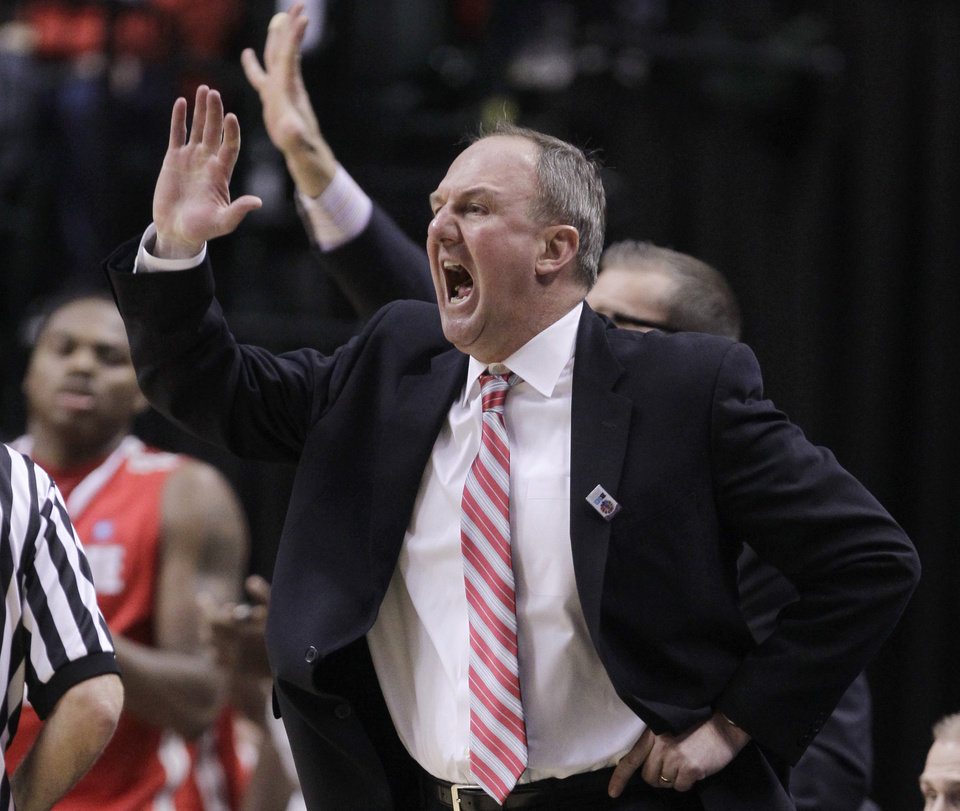 Photo -   Ohio State head coach Thad Matta directs his team in the first half of an NCAA college basketball game against Michigan in the semifinals of the Big Ten Conference tournament in Indianapolis, Saturday, March 10, 2012. (AP Photo/Michael Conroy)