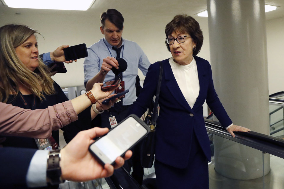 Photo - Sen. Susan Collins, R-Maine, arrives at the U.S. Capitol in Washington, Friday, Jan. 31, 2020, during the impeachment trial of President Donald Trump on charges of abuse of power and obstruction of Congress. (AP Photo/Julio Cortez)