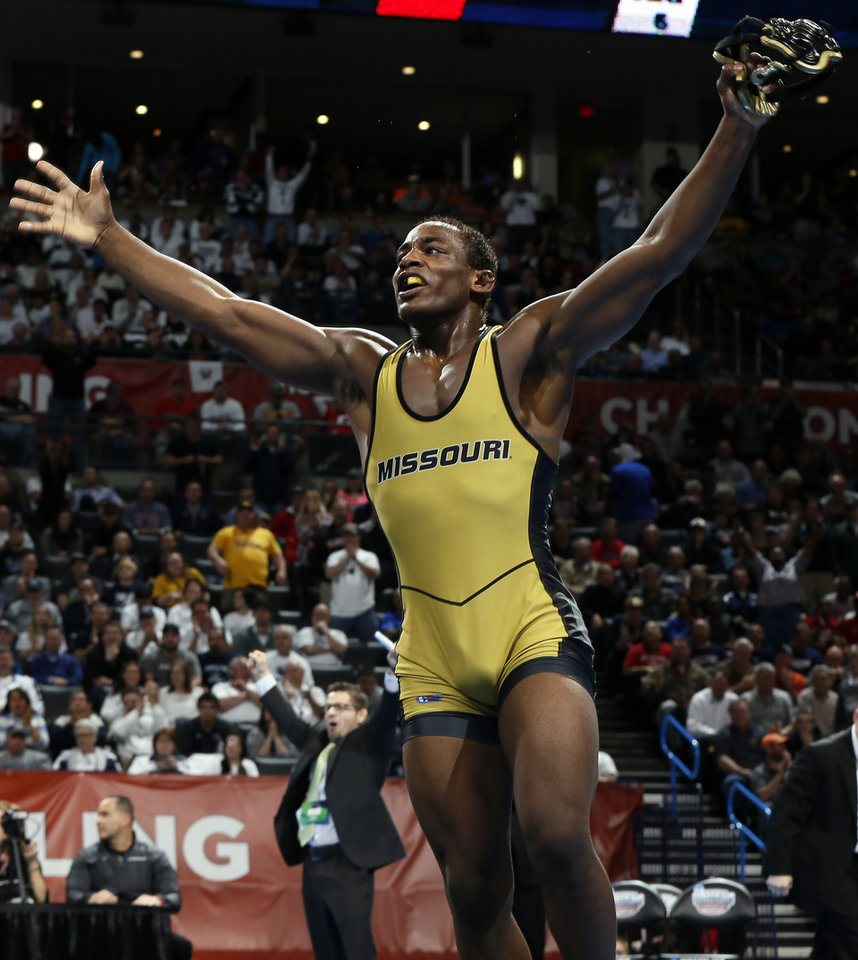 Photo - Missouri's J'Den Cox celebrates after defeating Ohio State's Nick Heflin, not pictured, to win the 197-pound national championship in the 2014 NCAA Div. I Wrestling Championships at Chesapeake Energy Arena in Oklahoma City, Saturday, March 22, 2014. Photo by Nate Billings, The Oklahoman