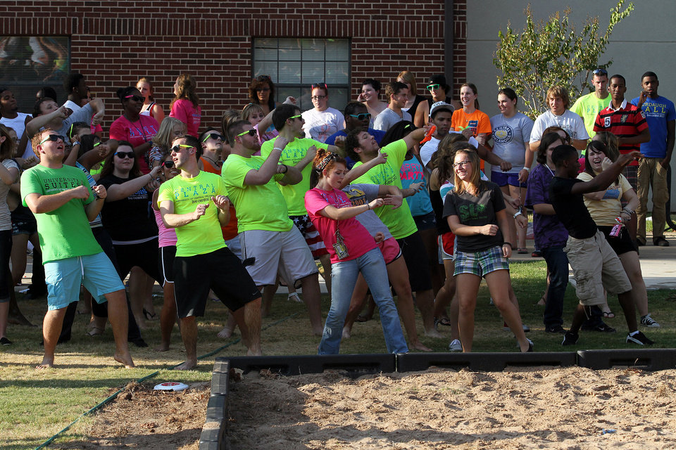 Photo - Students dance together during the move-in week activities.