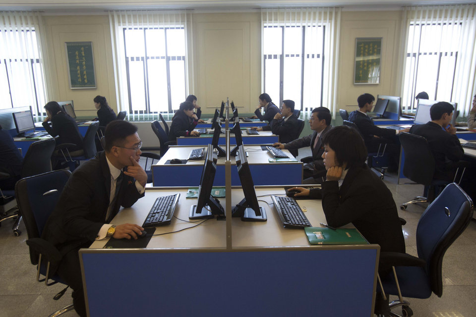 Photo - FILE - In this Jan. 8, 2013 file photo, North Korean students surf the internet at computer terminals inside a computer lab at Kim Il Sung University in Pyongyang, North Korea  during a tour by Executive Chairman of Google, Eric Schmidt. North Korea on Friday, March 15, 2013,  blamed South Korea and the United States for cyberattacks that temporarily shut down websites this week at a time of elevated tensions over the North's nuclear ambitions. Experts, however, indicated it could take months to determine what happened and one analyst suggested more likely culprits: hackers in China.  (AP Photo/David Guttenfelder, File)