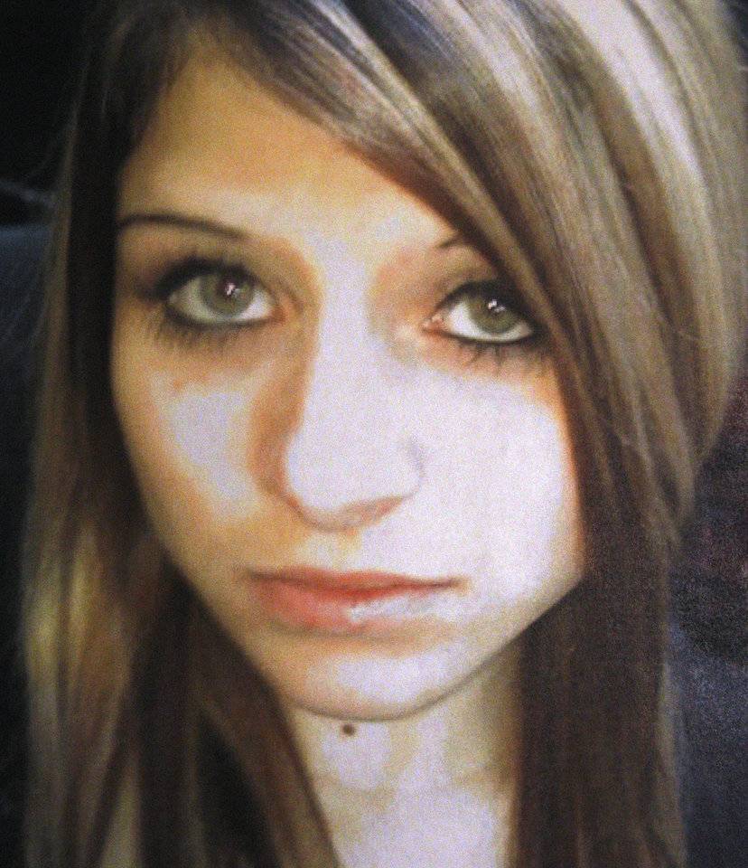 This undated file photo provided by the Bethany Police Department shows Carina Saunders, whose remains were found behind a grocery store in 2011. Uncredited