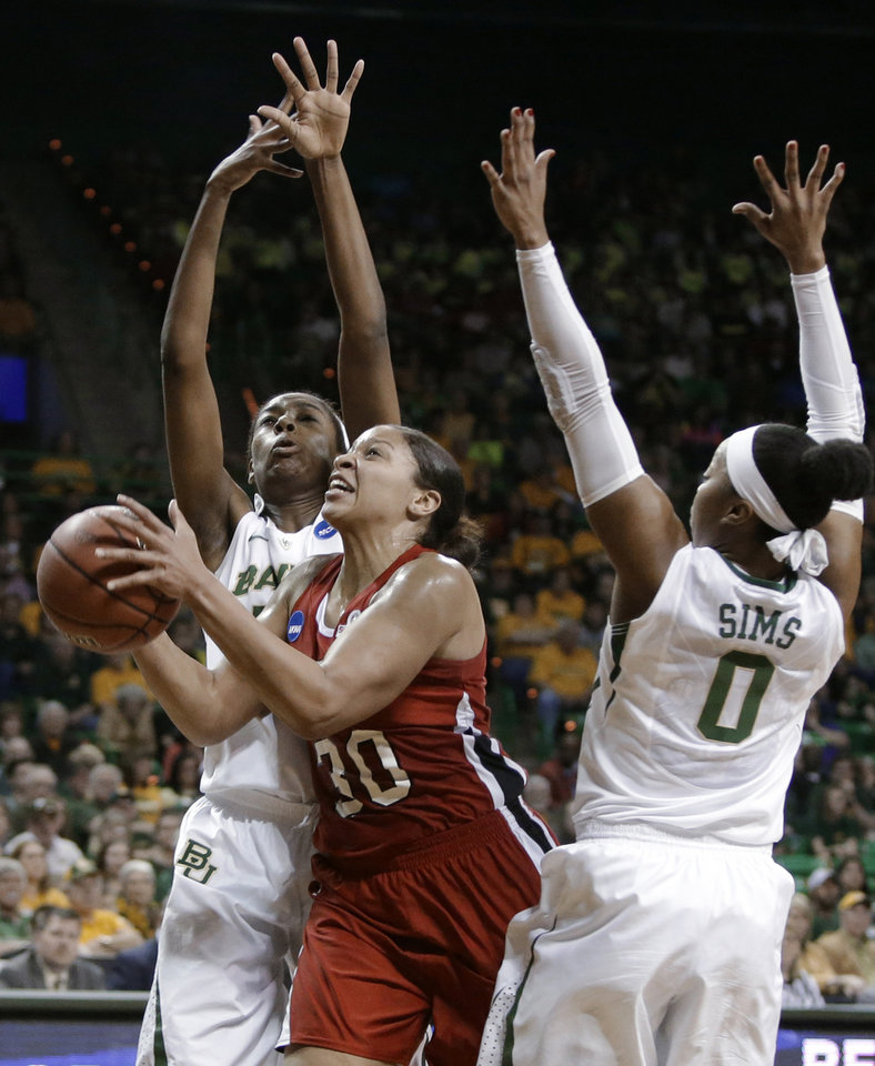 Photo - Western Kentucky's Chastity Gooch (30) goes up for a shot between Baylor's Odyssey Sims (0) and Khadijiah Cave, left, in the first half of a first-round game in the NCAA women's college basketball tournament, Saturday, March 22, 2014, in Waco, Texas. (AP Photo/Tony Gutierrez)