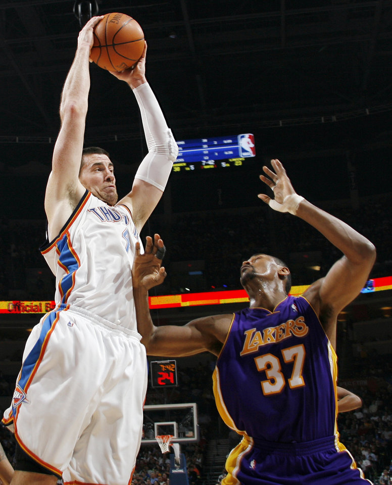 Oklahoma City\'s Nick Collison (4) grabs a rebound next to Ron Artest (37) of Los Angeles during the NBA basketball game between the Los Angeles Lakers and the Oklahoma City Thunder at the Ford Center in Oklahoma City, Friday, March 26, 2010. Photo by Nate Billings, The Oklahoman
