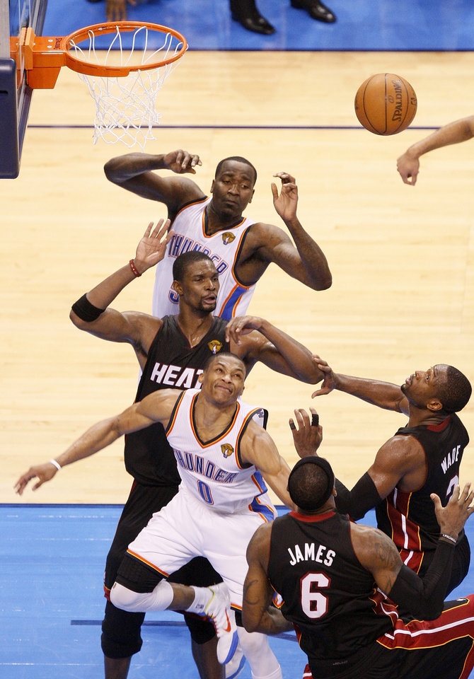 Photo - Oklahoma City's Kendrick Perkins (5), top, and  Russell Westbrook (0), lower left, along with Miami's Chris Bosh (1), middle left, LeBron James (6) and Dwyane Wade (3) try to rebound missed shot by Oklahoma City's Kevin Durant (not pictured) over Miami's Lebron James that would have tied the game late in the fourth quarter during Game 2 of the NBA Finals between the Oklahoma City Thunder and the Miami Heat at Chesapeake Energy Arena in Oklahoma City, Thursday, June 14, 2012. Miami won, 100-96. Photo by Nate Billings, The Oklahoman