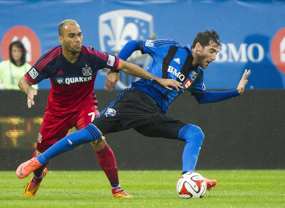 Photo - Montreal Impact's Ignacio Piatti, right, and Chicago Fire's Alex compete for the ball during the first half of an MLS soccer game Saturday, Aug. 16, 2014, in Montreal. (AP Photo/The Canadian Press, Graham Hughes)