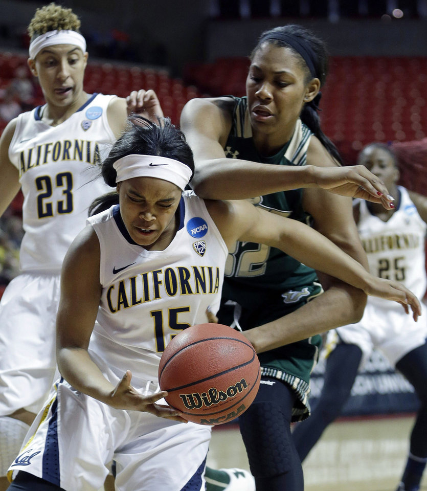 Photo - California guard Brittany Boyd (15) and South Florida center Akila McDonald (32) battle for the ball during the first half of a second-round game in the women's NCAA college basketball tournament in Lubbock, Texas, Monday, March 25, 2013. California guard Layshia Clarendon (23) watches. (AP Photo/LM Otero)