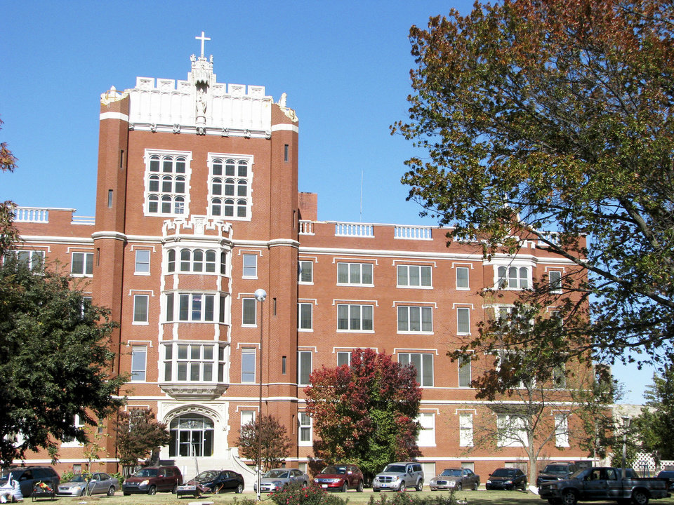 Photo - Benedictine Hall on the Campus of St. Gregory's University in Shawnee. The iconic building has been without turrets on it's top corners since they were damaged in the 5.6 magnitude earthquake on Nov. 5 2011. Photo by Vallery Brown, The Oklahoman