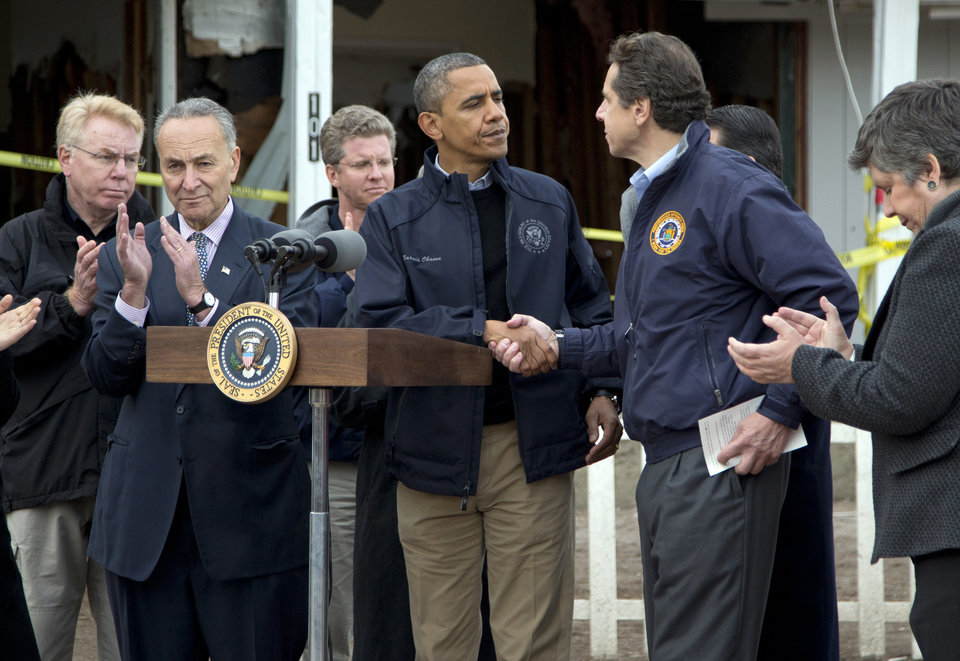 <p>President Barack Obama shakes hands with New York Gov. Andrew Cuomo, during a news conference on Cedar Grove Avenue, a street significantly impacted by Superstorm Sandy, on Staten Island, Thursday, Nov. 15, 2012, in New York. Sen. Charles Schumer, D-N.Y., is second from left, Secretary of Housing and Urban Development Shaun Donovan is third from left, and Secretary of Homeland Security Janet Napolitano is right. (AP Photo/Carolyn Kaster)</p>