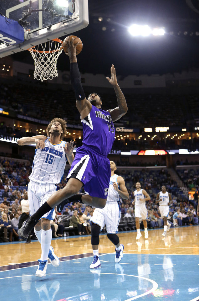 Photo - Sacramento Kings center DeMarcus Cousins (15) drives to the basket past New Orleans Hornets center Robin Lopez (15) in the first half of an NBA basketball game in New Orleans, Sunday, Feb. 24, 2013. (AP Photo/Gerald Herbert)