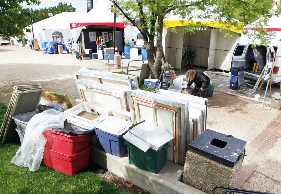 Photo - Stacks of art await hanging Monday in preparation for the Festival of the Arts in downtown Oklahoma City. The festival opens today. Photo By Paul Hellstern, The Oklahoman