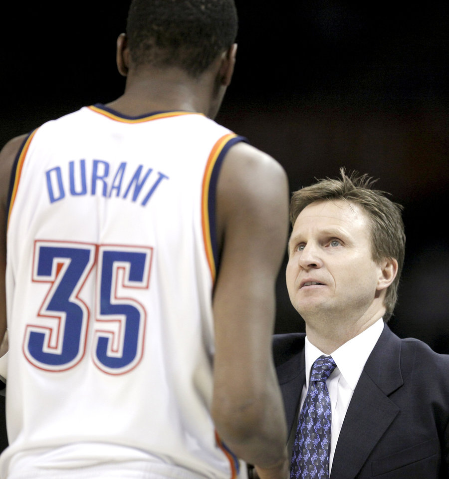 Photo - Oklahoma City head coach Scott Brooks talks to Kevin Durant during a timeout during the NBA basketball game between Oklahoma City Thunder and San Antonio Spurs, Tuesday April 7, 2009, at the Ford Center in  Oklahoma CIty. Photo by Sarah Phipps, The Oklahoma ORG XMIT: KOD
