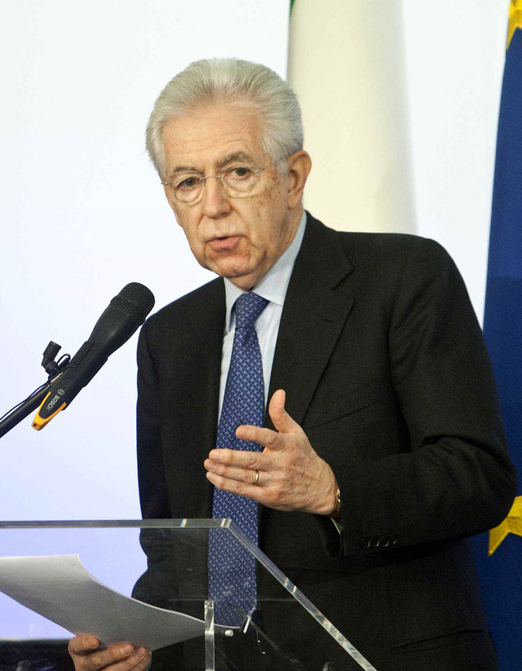 Photo - Italian Premier Mario Monti speaks during a news conference in Rome, Sunday, Dec. 23, 2012. Mario Monti on Sunday said is spurning he won't take up Silvio Berlusconi's offer to run on a center-right election ticket backed the by media mogul, citing Berlusconi's heavy criticism of his economic policies. Monti, now in a caretaker role following his resignation last, has kept Italy waiting to hear if he has decided to run or not in in Feb. 24-25 elections. (AP Photo/Mauro Scrobogna, Lapresse)