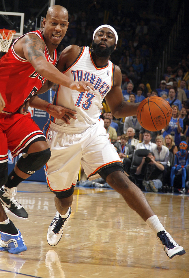 Photo - Oklahoma City's James Harden tries to get by Chicago's Ketih Bogans during the NBA season opener basketball game between the Oklahoma City Thunder and the Chicago Bulls in the Oklahoma City Arena on Wednesday, Oct. 27, 2010. Photo by Sarah Phipps, The Oklahoman