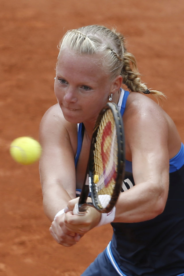 Photo - Netherlands' Kiki Bertens returns the ball during the fourth round match of the French Open tennis tournament against Germany's Andrea Petkovic at the Roland Garros stadium, in Paris, France, Monday, June 2, 2014.  (AP Photo/Darko Vojinovic)