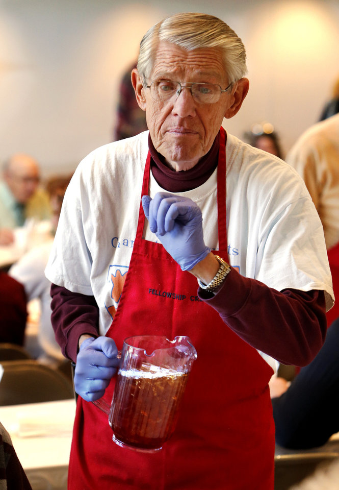 Left: Gary Tesch serves iced tea to customers Tuesday at the annual Benefit Bean Dinner, which raises money for Health for Friends' medication fund.