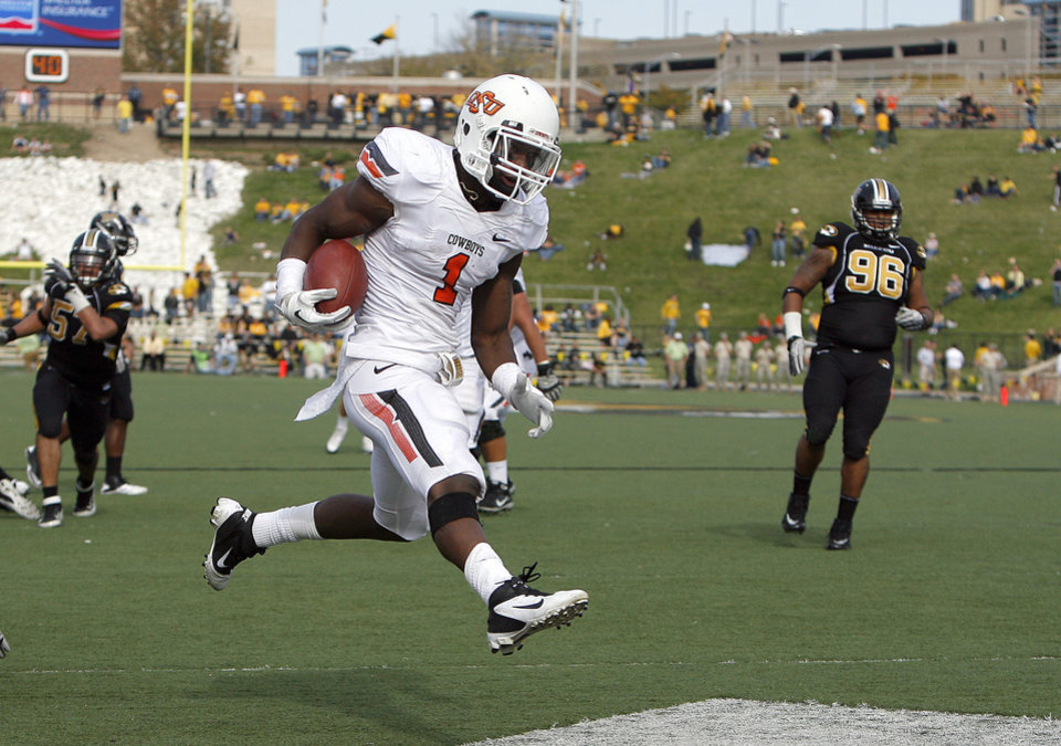 Photo - Oklahoma State's Joseph Randle (1) scores a touchdown late in the fourth quarter during a college football game between the Oklahoma State University Cowboys (OSU) and the University of Missouri Tigers (Mizzou) at Faurot Field in Columbia, Mo., Saturday, Oct. 22, 2011. Photo by Sarah Phipps, The Oklahoman