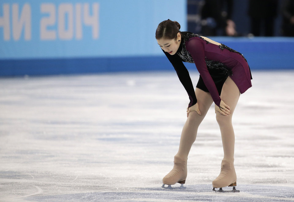 Photo - Yuna Kim of South Korea reacts after competing in the women's free skate figure skating finals at the Iceberg Skating Palace during the 2014 Winter Olympics, Thursday, Feb. 20, 2014, in Sochi, Russia. (AP Photo/Bernat Armangue)