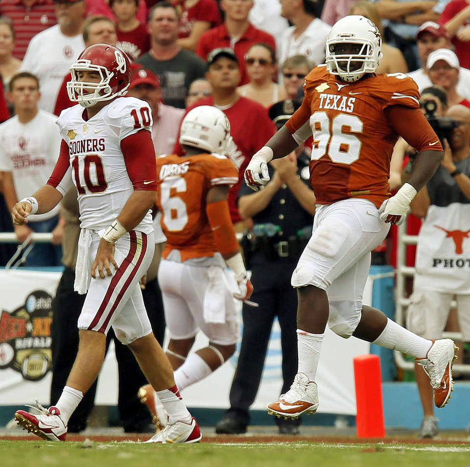 OU's Blake Bell (10) walks to the sideline after Chris Whaley (96) intercepted a pass by Bell for a touchdown in the first quarter during the Red River Rivalry college football game between the University of Oklahoma Sooners and the University of Texas Longhorns at the Cotton Bowl Stadium in Dallas, Saturday, Oct. 12, 2013. Photo by Nate Billings, The Oklahoman