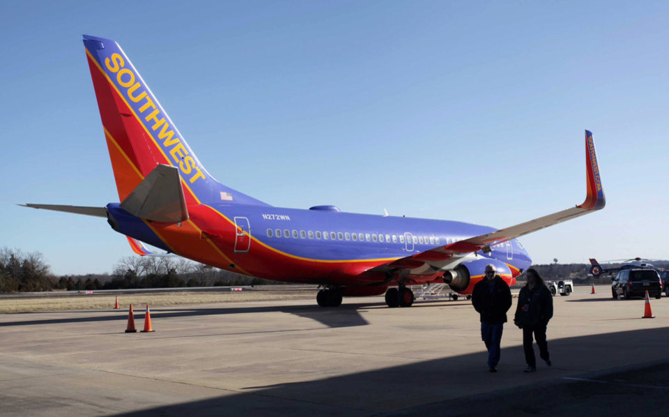 Photo - FILE - In this Jan. 13, 2014 file photo, Southwest Airlines Flight 4013 sits at the M. Graham Clark Downtown Airport in Hollister, Mo. On nearly 150 flights, U.S. commercial air carriers have either landed at the wrong airport or started to land and realized their mistake in time, according to a search by The Associated Press of government safety databases and media reports since the early 1990s. (AP Photo/Springfield News-Leader, Valerie Mosley, File)