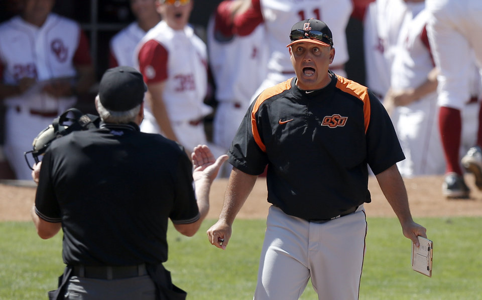 Photo - Oklahoma State head coach Josh Holliday argues a home plate call during the Bedlam baseball game between the University of Oklahoma and Oklahoma State University at the Chickasaw Bricktown Ballpark in Oklahoma CIty, Sunday, May 12, 2013. Photo by Sarah Phipps, The Oklahoman