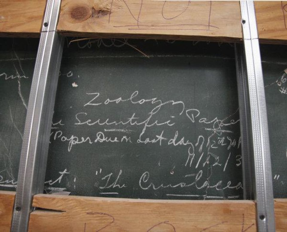 A decades-old chalkboard with writing still intact is shown at Longfellow Middle School. The chalkboard was discovered behind a wall during renovation work. PHOTO BY STEVE SISNEY, THE OKLAHOMAN <strong>STEVE SISNEY - THE OKLAHOMAN</strong>