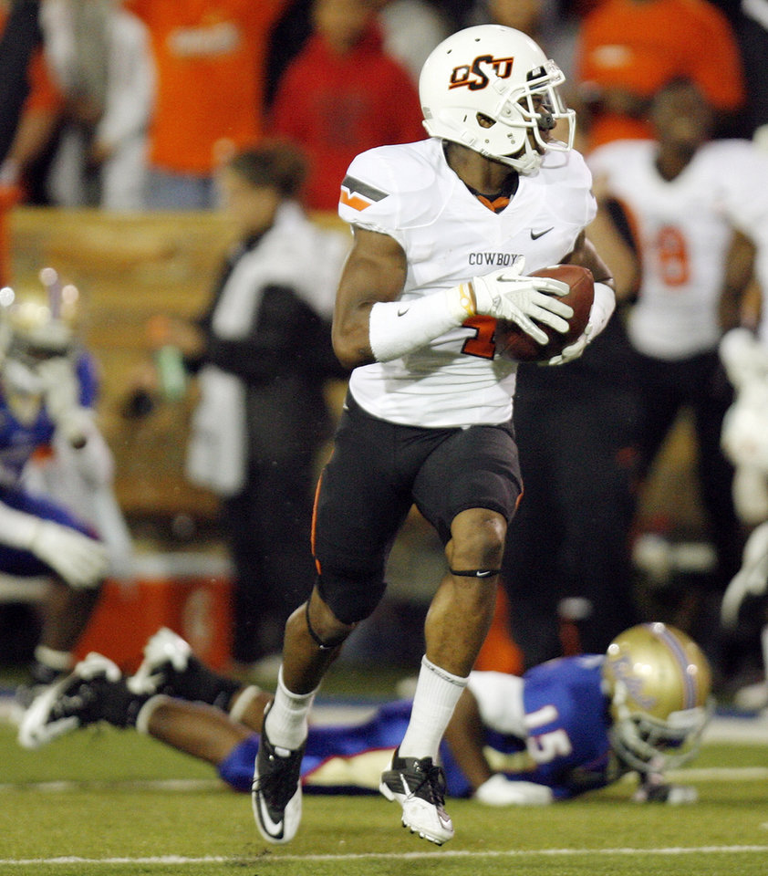 Photo - OSU's Justin Gilbert (4) returns a kickoff for a touchdown in the first quarter during a college football game between the Oklahoma State University Cowboys  and the University of Tulsa Golden Hurricane at H.A. Chapman Stadium in Tulsa, Okla., Sunday morning, Sept. 18, 2011. Photo by Nate Billings, The Oklahoman