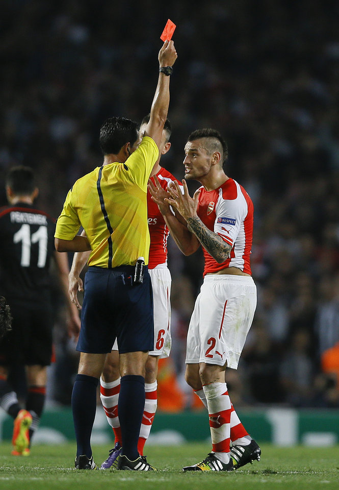Photo - Arsenal's Mathieu Debuchy is given a red card during a second leg Champions League qualifying soccer match between Arsenal and Besiktas at Emirates Stadium in London Wednesday, Aug. 27, 2014.(AP Photo/Kirsty Wigglesworth)