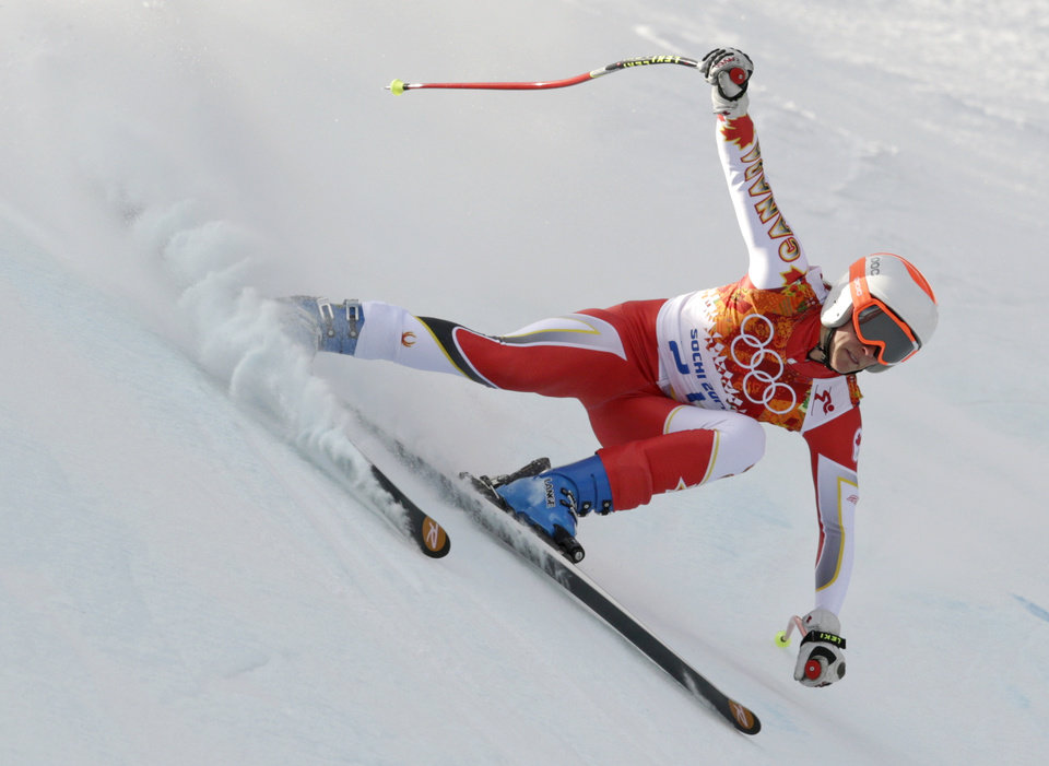 Photo - Canada's Marie-Michele Gagnon makes a turn during the downhill portion of the women's supercombined at the Sochi 2014 Winter Olympics, Monday, Feb. 10, 2014, in Krasnaya Polyana, Russia. (AP Photo/Charles Krupa)
