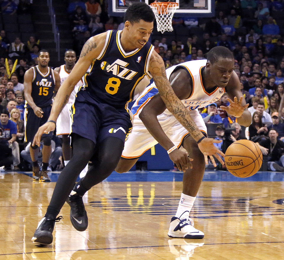 Oklahoma City\'s Reggie Jackson (15) gets a loose ball from Utah\'s Diante Garrett (8) during the NBA game between the Oklahoma City Thunder and the Utah Jazz at the Chesapeake Energy Arena, Sunday, Nov. 24, 2013. Photo by Sarah Phipps, The Oklahoman
