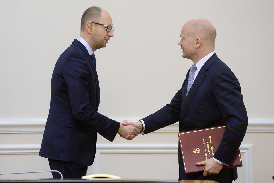 Photo - Ukrainian Prime Minister Arseniy Yatsenyuk, left, shakes hands with British Foreign Secretary William Hague in Kiev, Ukraine, Monday, March 3, 2014. Pro-Russian troops took over a ferry terminal on the easternmost tip of Crimea close to Russia on Monday, exacerbating fears that Moscow is planning to bring even more troops into this strategic Black Sea region. (AP Photo/Andrew Kravchenko, Pool)