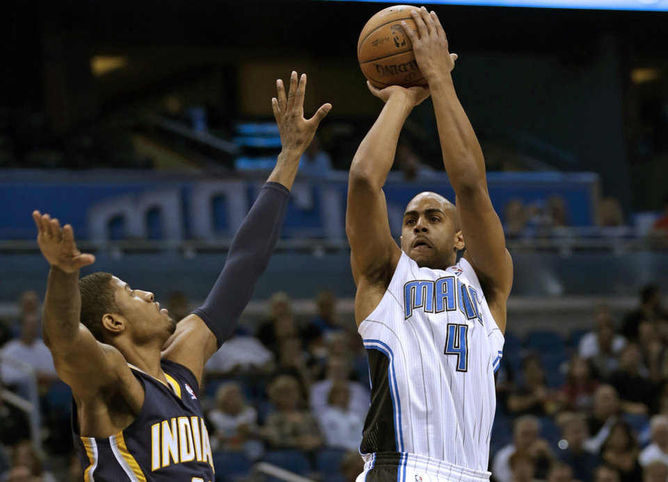 Orlando Magic's Arron Afflalo (4) shoots over Indiana Pacers' Paul George, left, during the first half of an NBA basketball game, Wednesday, Jan. 16, 2013, in Orlando, Fla. (AP Photo/John Raoux)