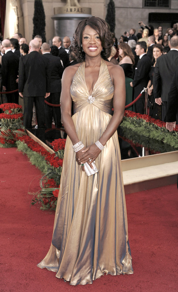 Photo - Viola Davis channeled old Hollywood glamour in a Reem Acra metallic halter gown.AP PHOTO