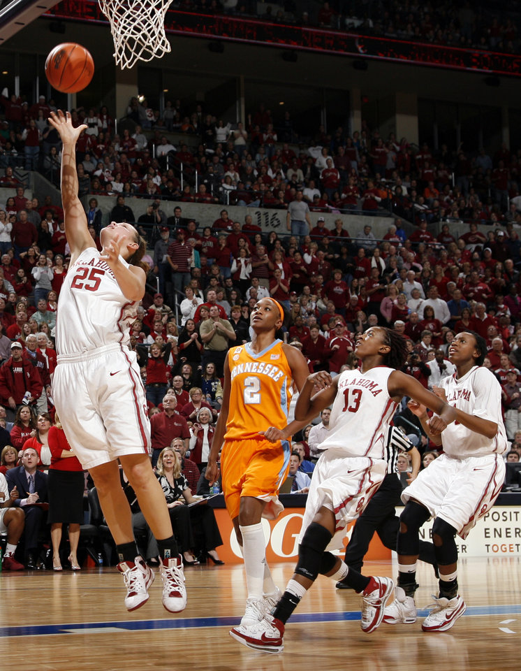 OU's Whitney Hand lays up the ball as Tennessee's Alex Fuller along with OU's Danielle Robinson (13) and Nyeshia Stevenson (1) watch in the second half of a 2009 game vs. Tennessee. PHOTO BY NATE BILLINGS, The Oklahoman Archives