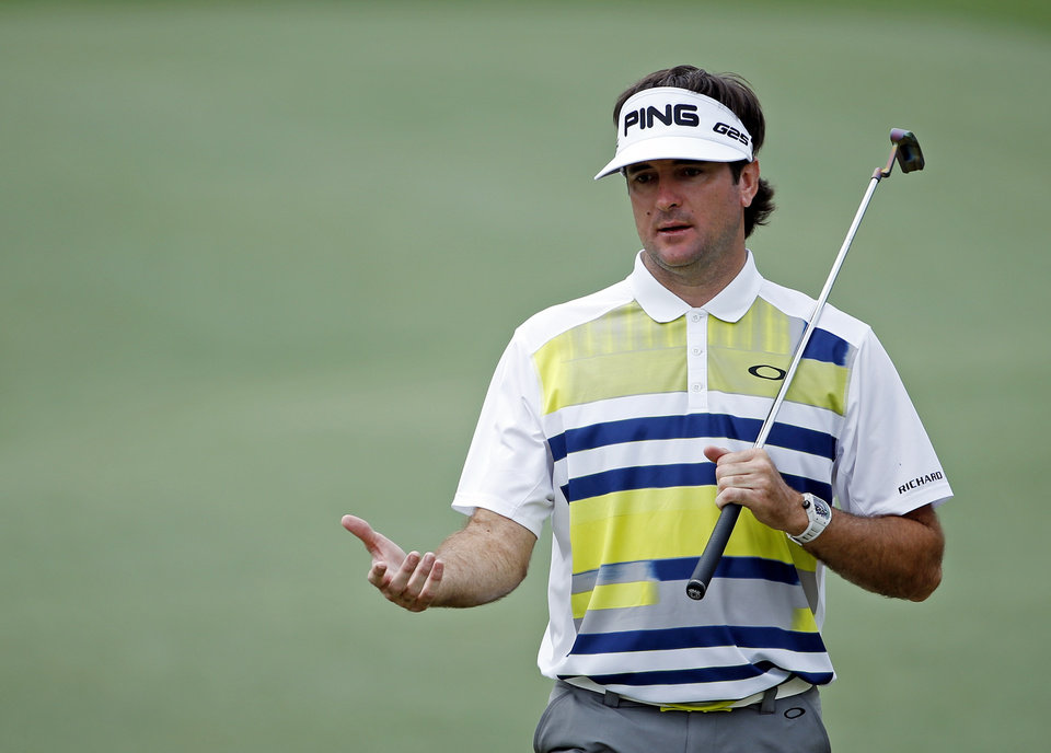 Photo - Bubba Watson walks down the 14th fairway during the second round of the Masters golf tournament Friday, April 11, 2014, in Augusta, Ga. (AP Photo/Matt Slocum)