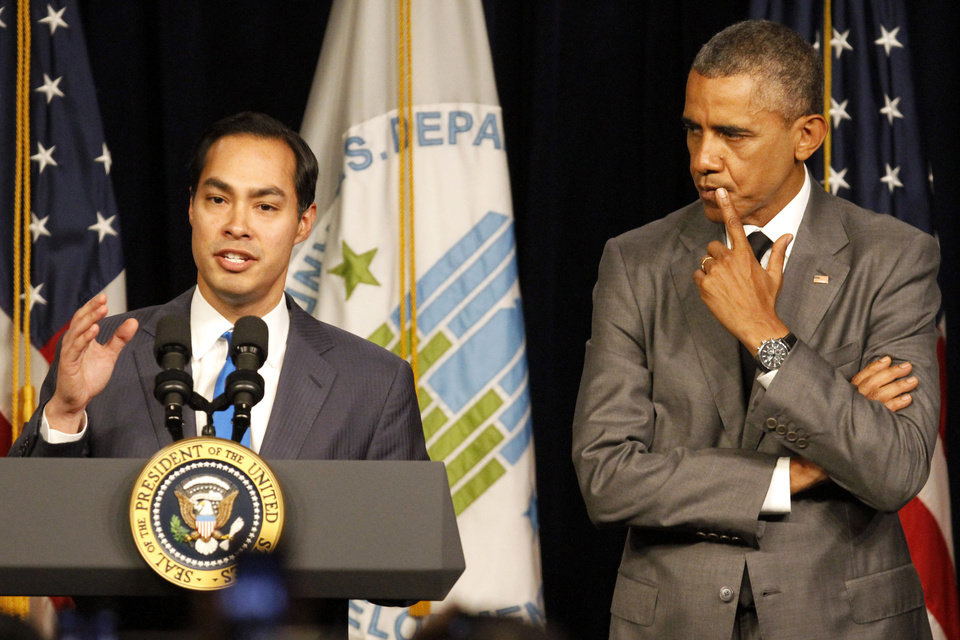 Photo - President Barack Obama listens as he is introduced by new Housing and Urban Development Secretary Julian Castro, Thursday, July 31, 2014, at the Housing and Urban Development Department in Washington. (AP Photo/Jacquelyn Martin)