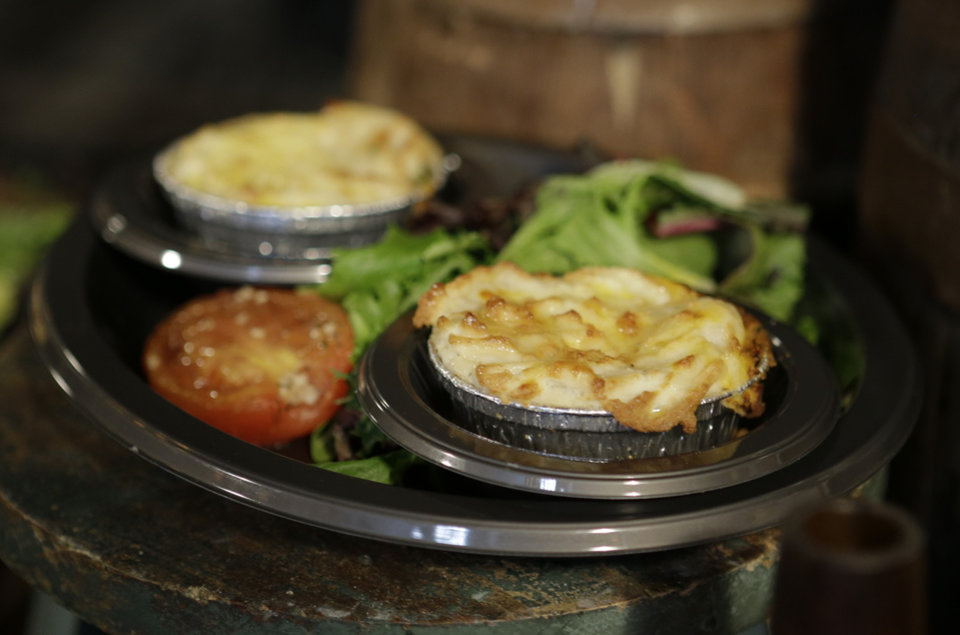 Photo - Mini pies that are available at the Leaky Cauldron restaurant are displayed during a preview of Diagon Alley at the Wizarding World of Harry Potter at Universal Orlando, Thursday, June 19, 2014, in Orlando, Fla. (AP Photo/John Raoux)