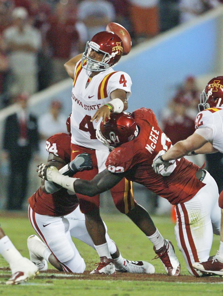 Iowa State quarterback Austen Armaud is called for intentional grounding while in the grasp of Frank Alexander (84) and Stacy McGee (92) during the first half of the college football game between the University of Oklahoma Sooners (OU) and the Iowa State Cyclones (ISU) at the Glaylord Family-Oklahoma Memorial Stadium on Saturday, Oct. 16, 2010, in Norman, Okla.  Photo by Steve Sisney, The Oklahoman