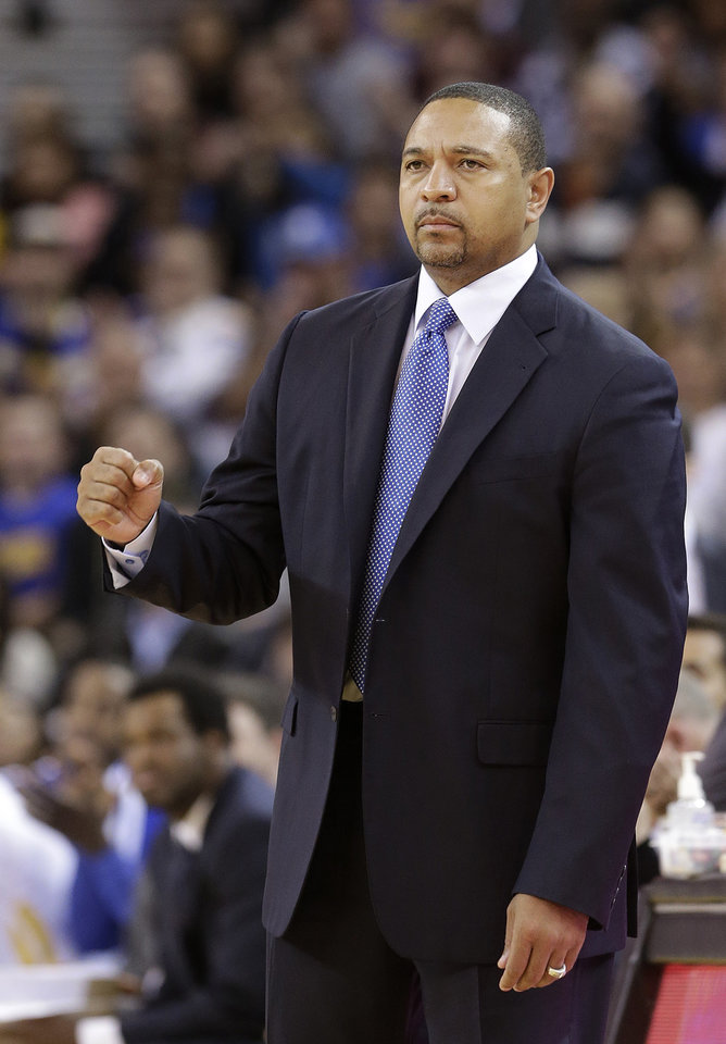 Photo - Golden State Warriors head coach Mark Jackson reacts after the team scored against the Utah Jazz during the second quarter of an NBA basketball game in Oakland, Calif., Saturday, Nov. 16, 2013. (AP Photo/Jeff Chiu)