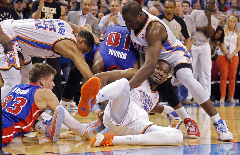 Photo - Oklahoma City's Kevin Durant (35), Serge Ibaka (9) and Thabo Sefolosha (25) battle Detroit's Jonas Jerebko (33) and Detroit's Greg Monroe (10) for a loose ball during the NBA basketball game between the Oklahoma City Thuder and the Detroit Pistons at Chesapeake Energy Arena in Oklahoma City, Okla. on Wednesday, April 16, 2014.  Photo by Chris Landsberger, The Oklahoman