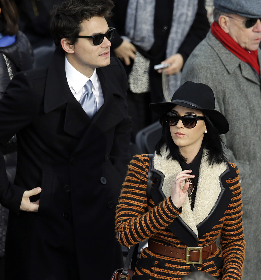 Photo - John Mayer and Katy Perry arrives for the ceremonial swearing-in of President Barack Obama at the U.S. Capitol during the 57th Presidential Inauguration in Washington, Monday, Jan. 21, 2013. (AP Photo/Carolyn Kaster)