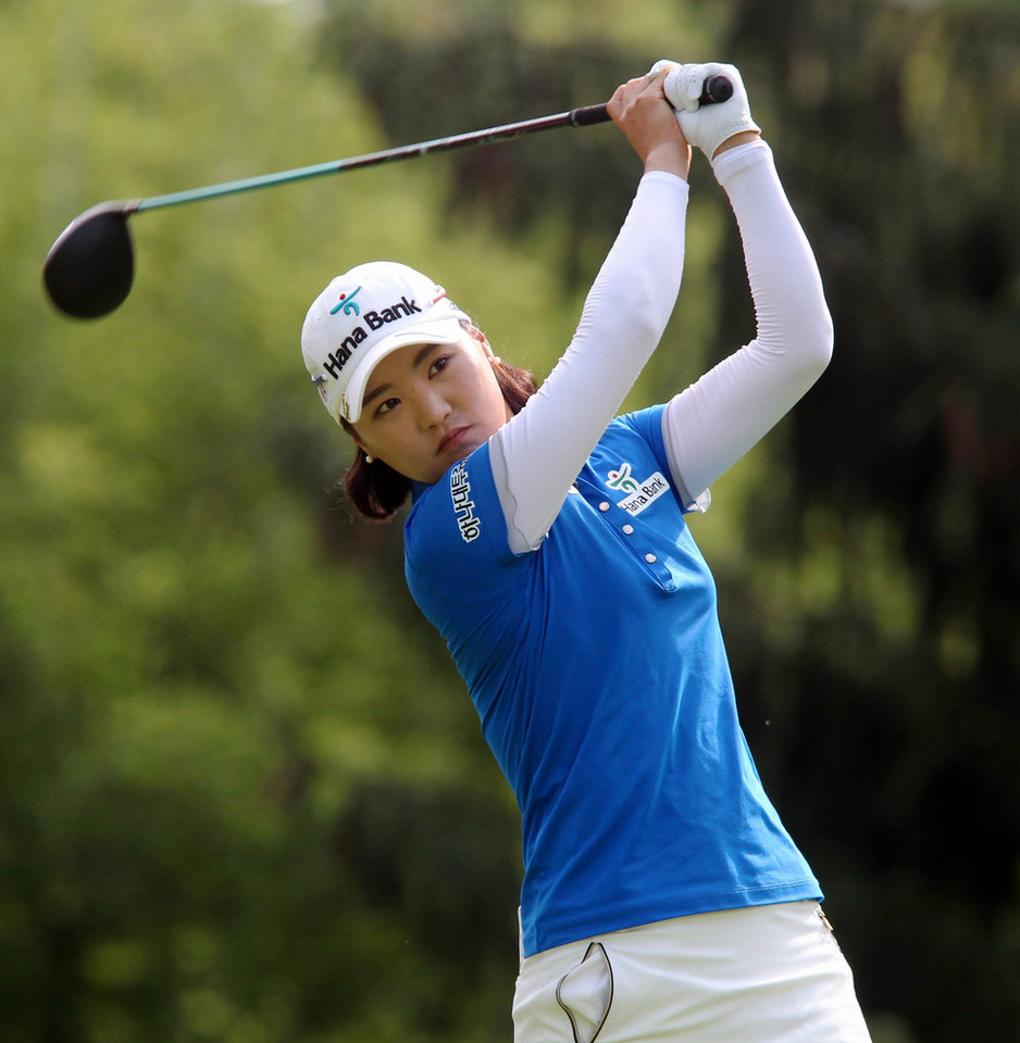 Photo - So Yeon Ryu, of South Korea watches her tee shot on the 14th hole at the Canadian Pacific Women's Open golf tournament in London, Ontario, Thursday, Aug. 21, 2014. (AP Photo/The Canadian Press, Dave Chidley)