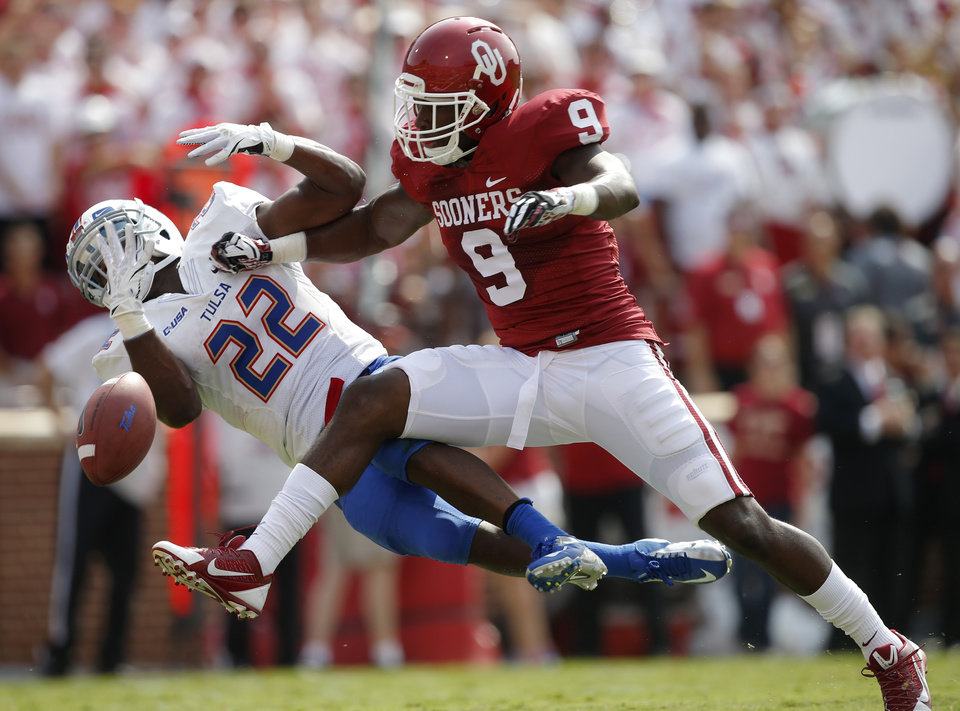 Oklahoma's Gabe Lynn (9) breaks up a pass intended for Trey Watts (22) but was called for a penalty on the play during a college football game between the University of Oklahoma Sooners (OU) and the Tulsa Golden Hurricane at Gaylord Family-Oklahoma Memorial Stadium in Norman, Okla., on Saturday, Sept. 14, 2013.  Photo by Bryan Terry, The Oklahoman