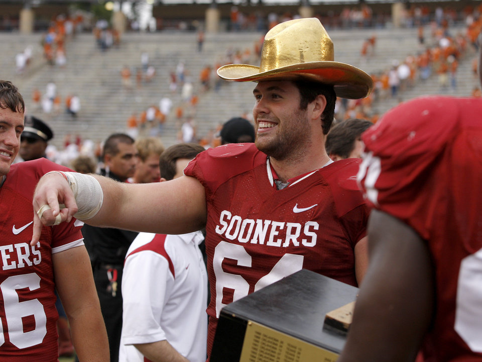 CELEBRATION: OU's Gabe Ikard (64) celebrates after the Red River Rivalry college football game between the University of Oklahoma (OU) and the University of Texas (UT) at the Cotton Bowl in Dallas, Saturday, Oct. 13, 2012. Oklahoma won 63-21. Photo by Bryan Terry, The Oklahoman